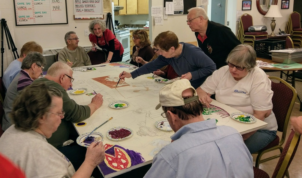 Seniors at the Taylor Community Center worked with Heart to Art a local arts group to work on a community mural to hang in their center.