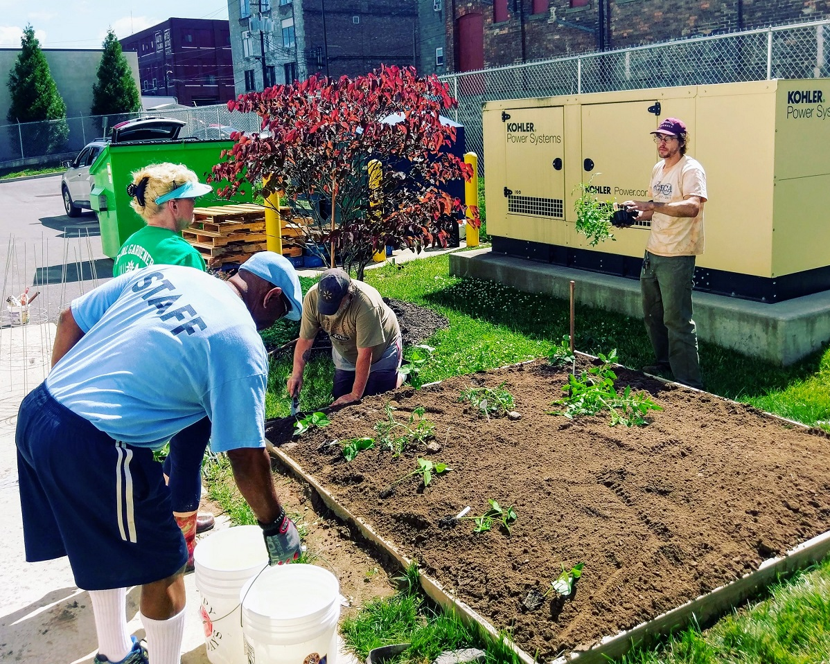 Veterans from the St. Francis Commons, a center for formerly homeless veterans in transition, build a garden with Master Gardners from Penn State Cooperative Extension.