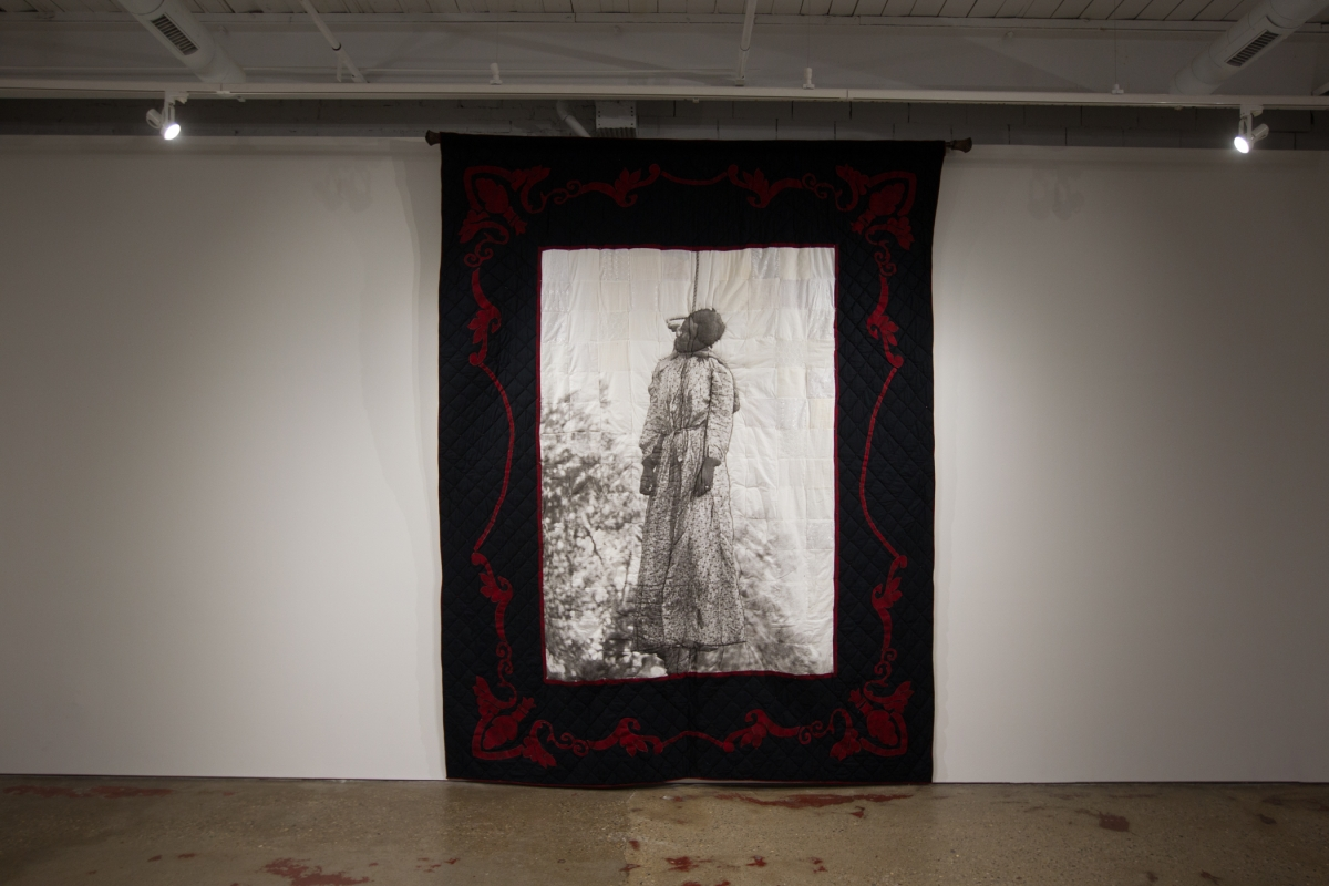 """Quilt I, Her Name was Laura Nelson"" explores issues around gender violence and familial bonds as they relate to lynching. Completed May 2004."