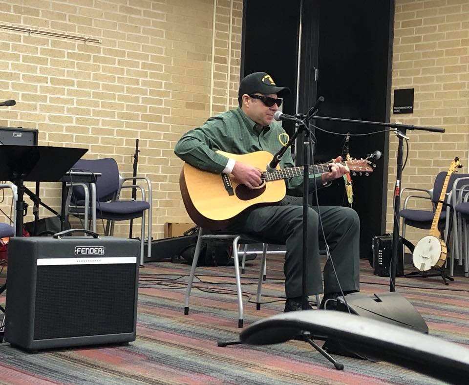 Veteran musician Rick Milisci performing at Library Live.