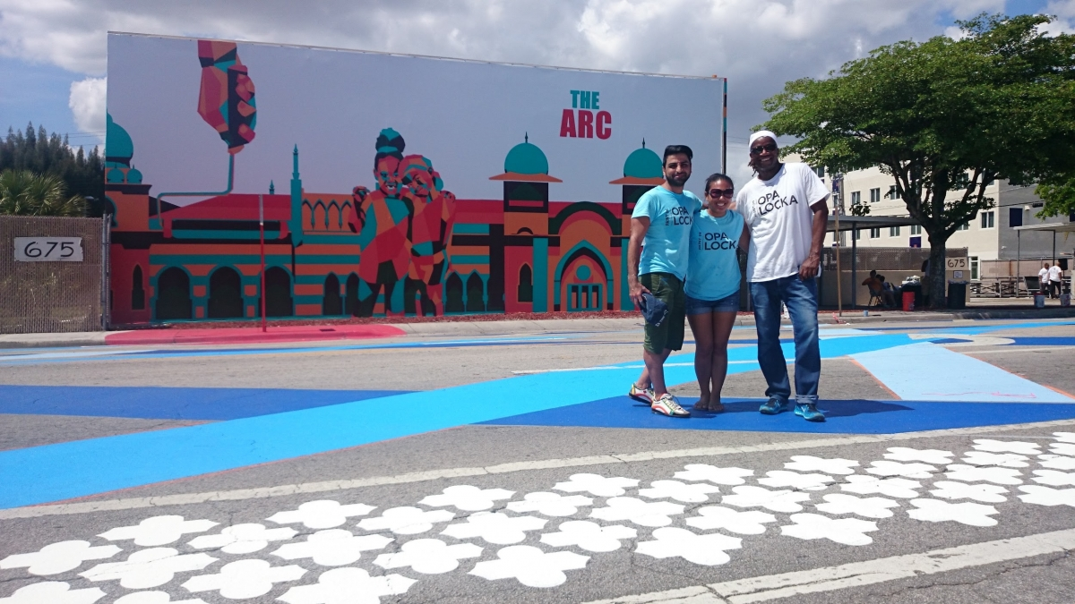 L-R: Artist Amir Baradaran, Aileen Alon, & artist/architect Walter Hood after completing a Community Paint Day, a partnership between OLCDC, Hood Design, City of Opa-locka, Miami Rise, Greater Miami Chamber of Commerce, local businesses, and over 200 residents and volunteers to paint the street and bike lane along Ali Baba Avenue. Copyright OLCDC, 2015.