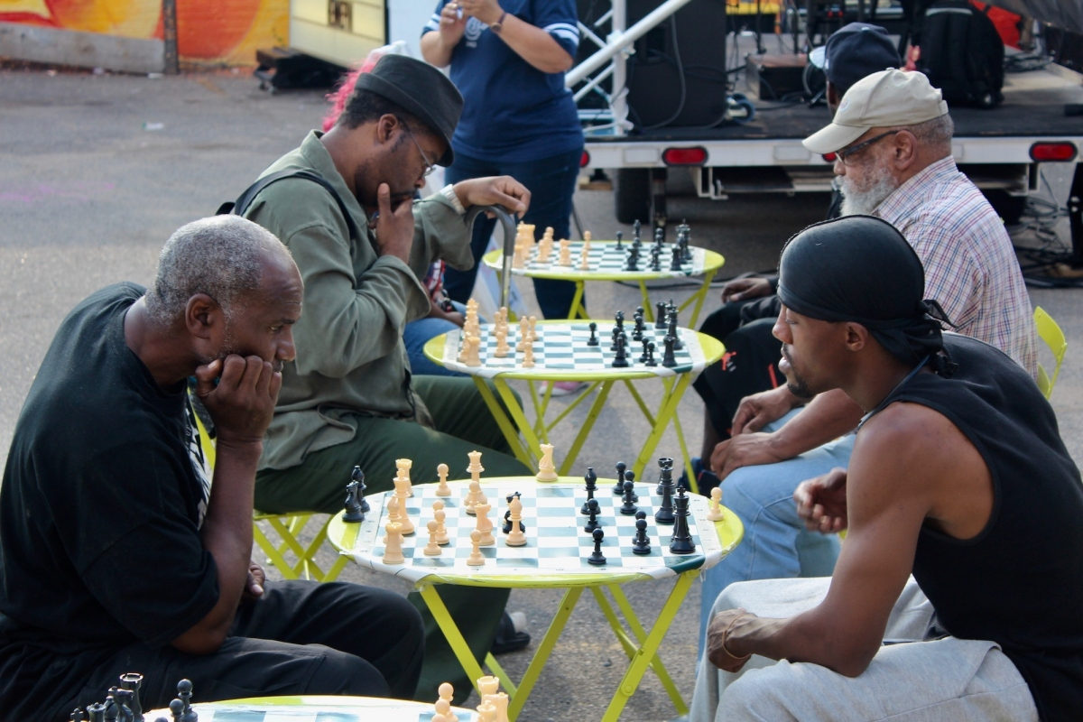 Playing chess in the Hennepin Theatre District. Photo by Katherine Peinhardt.