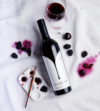Imagery cabernet with art supplies and berries