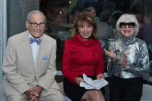 Harry Kullijian, Congresswoman Jackie Speier, and Carol Channing review the congressional resolution. Image by Jamie L. M
