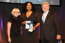Kristina Newman-Scott receives the Selina Roberts Ottum Award in 2018. She is flanked by Americans for the Arts Board Chair Julie Muraco and CEO Robert L. Lynch.